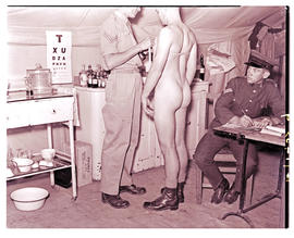 """Ladysmith, 1940. Physical examination at military camp."""