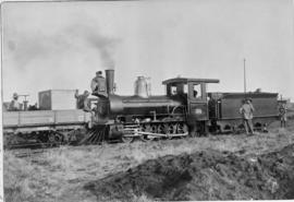 Bloemfontein district, 17 December 1890. CGR Class 01 No 123 at Kaalspruit, hauling the first tra...