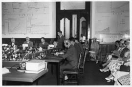 Lourenco Marques, Mozambique, 1959. Conference of General Managers. Conference room with floral a...