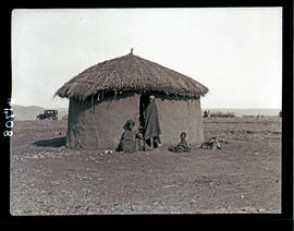 Transkei, 1932. People before typical hut.