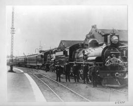 Pretoria, 1910. Royal Train with Duke and Duchess of Connaught at station hauled by CSAR Class 10...