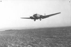 Junkers JU-52 in flight close to ground.