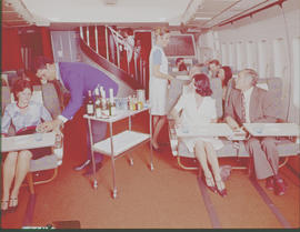 SAA Boeing 747 interior, passengers being served.