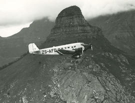 Cape Town, 1935. SAA Junkers Ju-52 ZS-AFD 'Sir Benjamin d' Urban' in flight past Lion's Head. SEE...