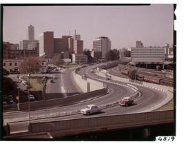 Johannesburg. View of city with motorway in the foreground.