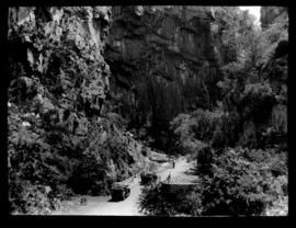 Round in Nine Tours - two vehicles before narrow gorge.