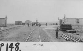 Bluecliff, 1895. Station buildings with small boy and sleepers in the foreground. (EH Short)