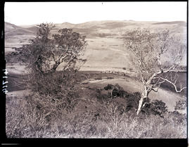 Transkei, 1932. Rolling hills with huts in the distance.
