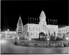 Port Elizabeth,  26 February 1947. City hall and post office buildings illuminated for the Royal ...