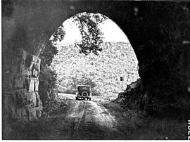 """Waterval-Boven, 1926. Motor car leaving old railway tunnel."""