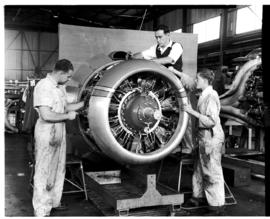 Johannesburg, circa 1949. Rand Airport. Technician in workshop working on aircraft engine. (JK Hora)