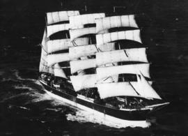 Aerial view of large sailing vessel at sea.