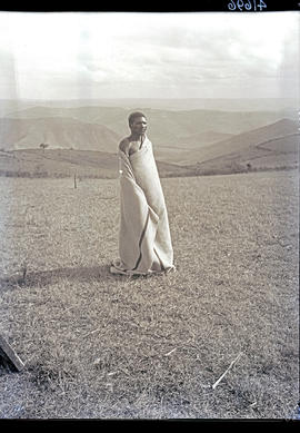 Transkei, 1932. Bomvaan man wrapped in blanket.