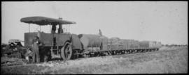 Roadrail tractor with goods trucks.