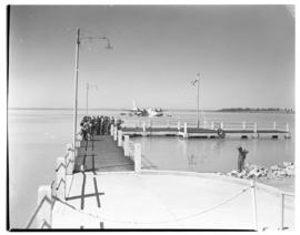 Vaal Dam, circa 1948. Arrival of BOAC Solent flying boat G-AHIN 'Southampton'. Jetty with aricraf...