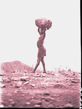 """Transkei, 1940. Xhosa girl carrying bag."""
