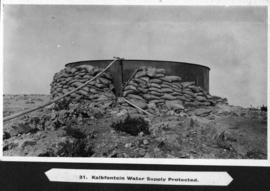 Page 32. Kalkfontein. Water tank protected by sand bags.
