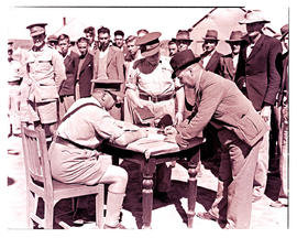 """Ladysmith, 1940. Signing in at military camp."""