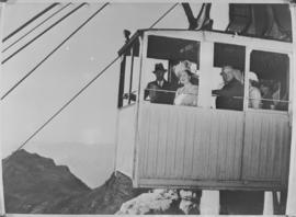 Cape Town, 21 April 1947. Queen Elizabeth and King George VI in the cablecar as it descends from ...
