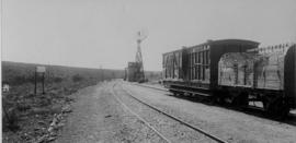 Wolwefontein, 1895. Goods train in station with water tank in the distance. (EH Short)