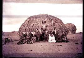 """Eshowe district, 1929. Zulu family in front of hut."""