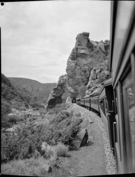 Louis Trichardt district, 1951. Passenger train approaching Waterpoort train tunnel in the Soutpa...