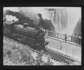 Victoria Falls, Zimbabwe. Victoria Falls from the railway bridge, with Rhodesian Railways 11th cl...