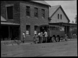Vryheid, 1923. SAR truck loading cans at creamery.