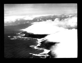 Aerial view of clouds at the coastline.