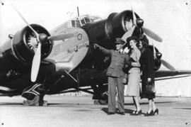 SAA Junkers JU-52 ZS-AJI 'Major Warden' with three people in the foreground.