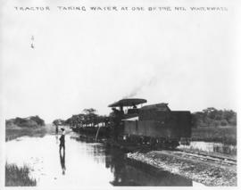 Naboomspruit district, circa 1924. Tractor taking water from the Nyl waterway. (Album on Naboomsp...