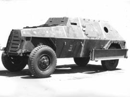 Four-wheeled armoured vehicle.