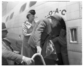 Vaal Dam, November 1949. BOAC Solent G-AHIX 'City of Edinburgh'. Hostess assisting passenger into...