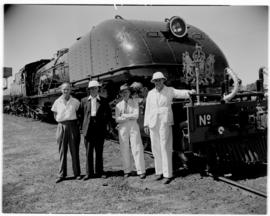 Livingstone, Northern Rhodesia, 11 April 1947. Rhodesian Railways staff in front of a RR Class 15...