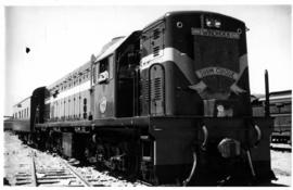 "Windhoek, South-West Africa. Arrival of first diesel locomotive, decorated ""Suum Cuique""."