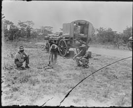 Zimbabwe. Cart with three men in open veld.