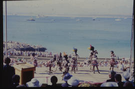 Traditional dancers at harbour.