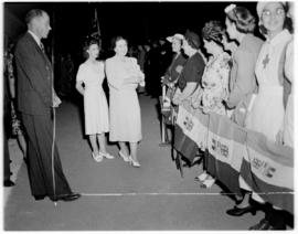 Ficksburg, 12 March 1947. Queen Elizabeth and Princess Margaret greeting women who are holding So...