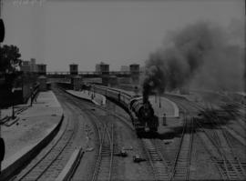 Johannesburg, 1936. SAR Class 16E No 858 with Union Limited leaving station.
