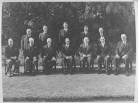 12 men in formal photograph. Prime Minister JC Smuts and King George VI in the front row?