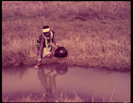 Melmoth district. Zulu girl fetching water at Nkandla.