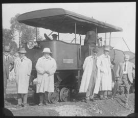 Dignitaries with roadrail tractor - left to right unknown, Hoffe, Dutton, Malan.