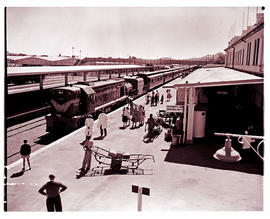 Windhoek, South-West Africa, 1961. SAR Class 32-000 No 32-048 with passenger train at railway sta...