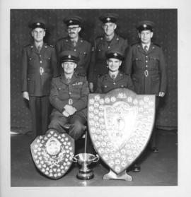 St John Ambulance Brigade. Group of uniformed men with trophy and two shields.
