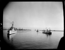 Cape Town, 17 February 1947. 'HMS Vanguard' entering Table Bay with SAR tugs in attendance.