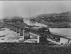 Eshowe district. Zululand Railways 2-6-0 built by Baldwin with construction train on the Tugela R...
