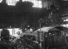 Cape Town, April 1947. Salt River locomotive workshop with SAR No 247* being repaired.