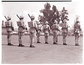 Army recruits in training, drill parade.