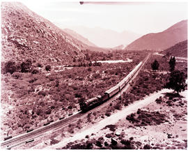 De Doorns, 1950. SAR Class 15F with Blue Train in the Hex River valley.