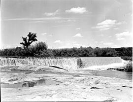 """Nelspruit district, 1946. Water overflowing weir in the Crocodile River."""